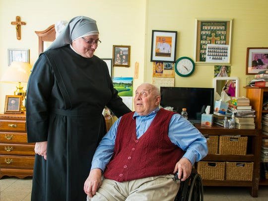 """Sister Constance Veit of Little Sisters of the Poor speaks with Carl """"The Mayor"""" Bergquist, 78, on March 21, 2016, in Washington."""