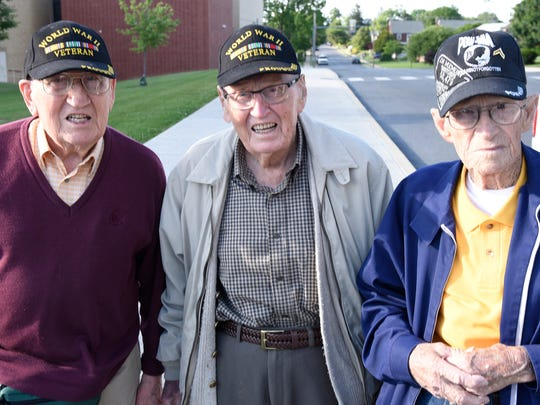 Brothers Harold Angle, 93, left, and Glenn Angle, 96, along with Emery P. Horn, 90, gather during a surprise welcome home event Wednesday, June 8, 2016 on Sixth Street, Chambersburg. Community of Chambersburg Girl Scouts 836 greeted the veterans. The WWII veterans, along with Emery P. Horn were returning home from a visit to France