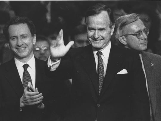Former President George H. W. Bush, right, with former