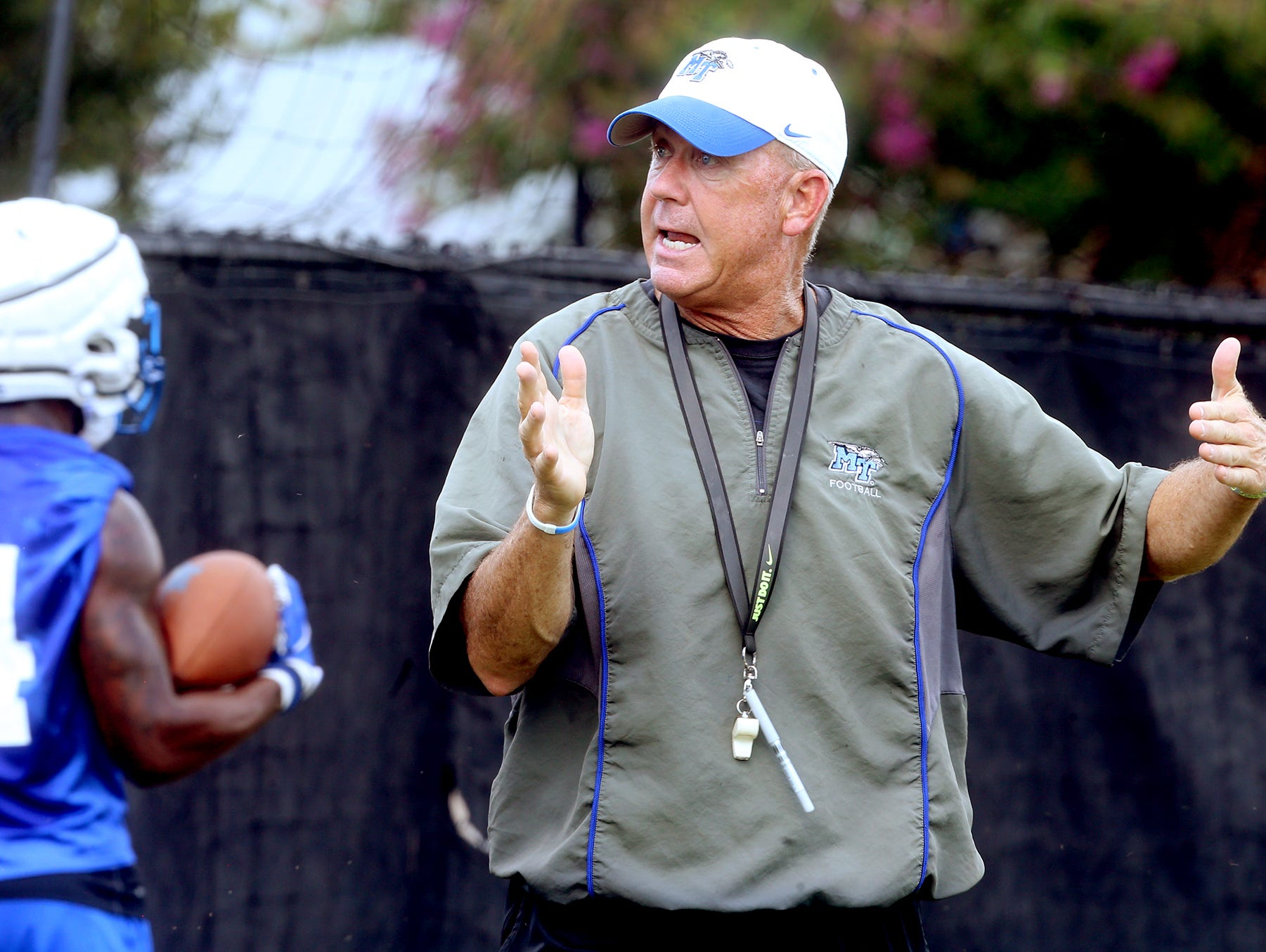 MTSU coach Rick Stockstill works with players during the first day of practice July 31, 2017.