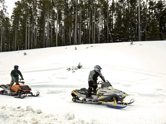 Snowmobilers take advantage of the excellent snow in the Little Belt Mountains.