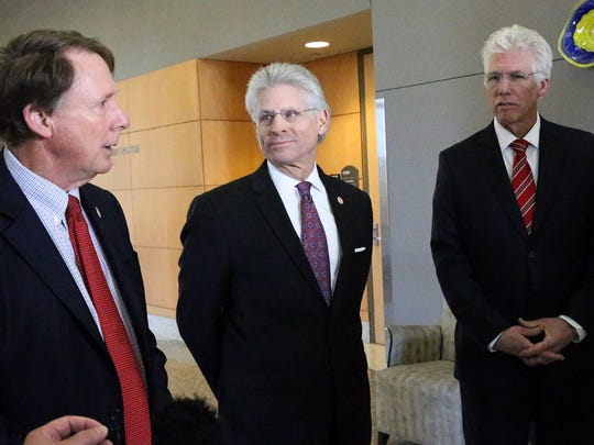 Texas Tech University System Chancellor Robert Duncan, left, board of regents Chairman Rick Francis, center, and Dr. Richard Lange, president of Texas Tech University Health Sciences Center El Paso, talk to reporters prior to a regents' board meeting Thursday in El Paso.