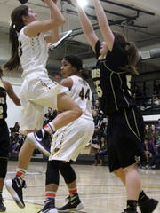 Brooke Anderson, left, puts up a shot while being defended by Hobbs' Allyson Doporto. Hobbs defeated Alamogordo 53-43 in the district opener Tuesday night.