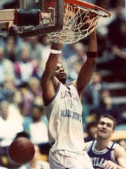 Hank Gathers slams two points through the hoop before
