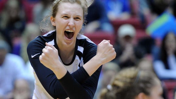 Beth Prince celebrates a kill. Avon defeated Carmel 3-1 in the 4A state volleyball championship game Saturday November 9, 2013 at Ball State University' Worthen Arena. Rob Goebel/The Star