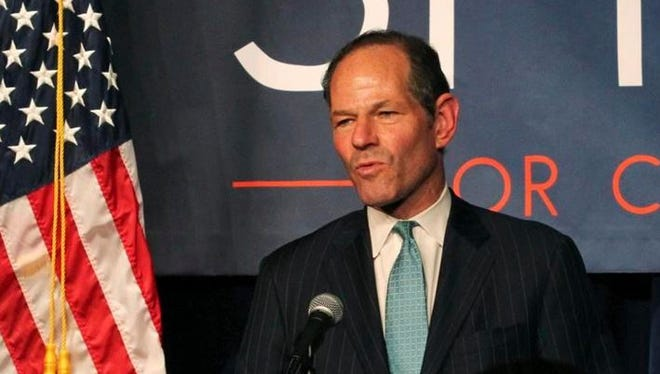 Former New York Gov. Eliot Spitzer delivers his concession speech at his election night party after losing the Democratic primary race for New York City comptroller in New York, Sept. 10, 2013. A 26-year-old woman who accused Spitzer of assaulting her has been arrested for trying to extort money from him. Police said Svetlana Zakharova was arrested in New York on Monday, Oct. 10, 2016.