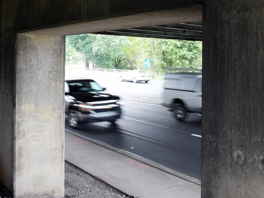 Traffic passes under I-83 on East Market Street where signs warn of signal timing changes on that section of road Monday, July 30, 2018. Left turn arrows in the area now cycle yellow, allowing traffic to turn left when oncoming traffic is clear. Bill Kalina photo