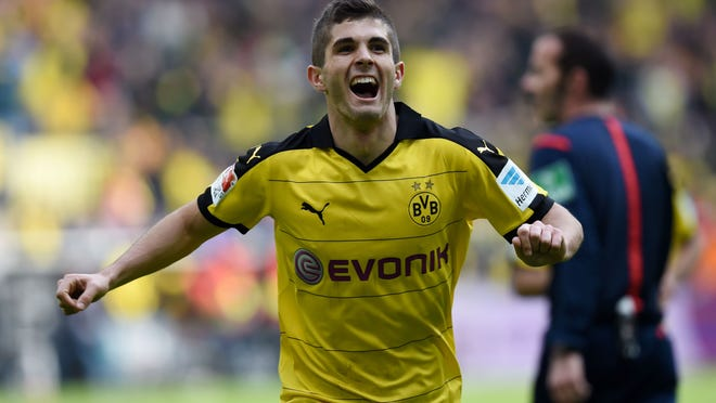 Dortmund's midfielder Christian Pulisic celebrates scoring the 1-0 goal during the German Bundesliga first division football match BVB Borussia Dortmund vs Hamburg SV in Dortmund, western Germany, on April 17, 2016.    / AFP PHOTO / PATRIK STOLLARZ / RESTRICTIONS: DURING MATCH TIME: DFL RULES TO LIMIT THE ONLINE USAGE TO 15 PICTURES PER MATCH AND FORBID IMAGE SEQUENCES TO SIMULATE VIDEO. == RESTRICTED TO EDITORIAL USE == FOR FURTHER QUERIES PLEASE CONTACT DFL DIRECTLY AT + 49 69 650050 PATRIK STOLLARZ/AFP/Getty Images ORG XMIT: 563324631 ORIG FILE ID: 551064388