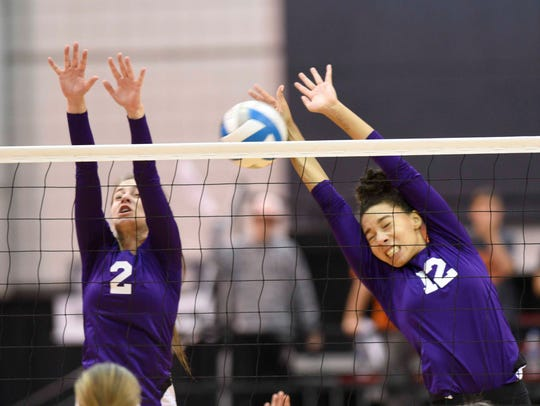 Plymouth Christian's Robyn Albert (2) and Caitlin Warnshuis (12) go up for the block in Thursday's Class D semifinal win over Rogers City.