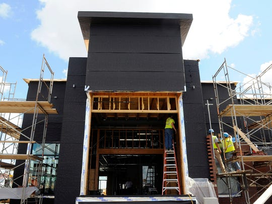 The tall portion of the Chick-fil-A building will house