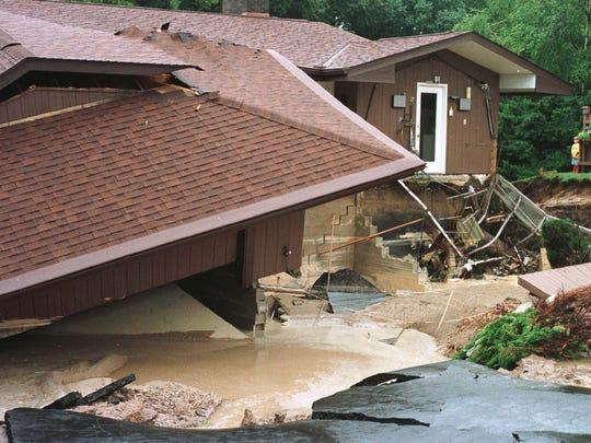 Heavy rains, Thursday, Aug. 6, 1998, collapsed the