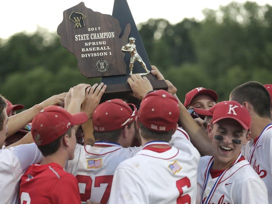 The Kimberly baseball team hosts its trophy after beating