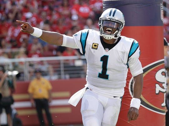 FILE - In this Sunday, Sept. 10, 2017 file photo, Carolina Panthers quarterback Cam Newton (1) celebrates after Jonathan Stewart scored a touchdown against the San Francisco 49ers during the second half of an NFL football game in Santa Clara, Calif. Buffalo Bills coach Sean McDermott spent the past six seasons going up against Cam Newton daily in practice. So you'd expect the Bills first-year coach to know a thing or two about how to slow down the league's 2015 MVP, right? McDermott joked the problem is he won't be on the field. The Bills play the Panthers on Sunday, Sept. 17, 2017. (AP Photo/Marcio Jose Sanchez, File)