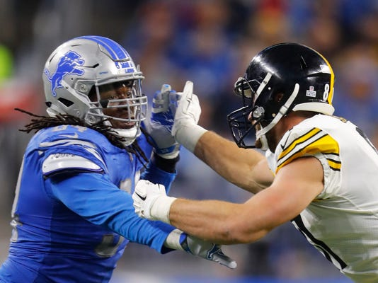 FILE - In this Oct. 29, 2017, file photo, Pittsburgh Steelers tight end Jesse James (81) blocks Detroit Lions defensive end Ezekiel Ansah (94) during an NFL football game in Detroit. The Lions have designated Ansah as their franchise player. The Lions announced the decision Tuesday, Feb. 27, 2018. Ansah, a first-round draft pick in 2013, has 44 sacks in five years with Detroit, including 12 this past season. (AP Photo/Paul Sancya, File)