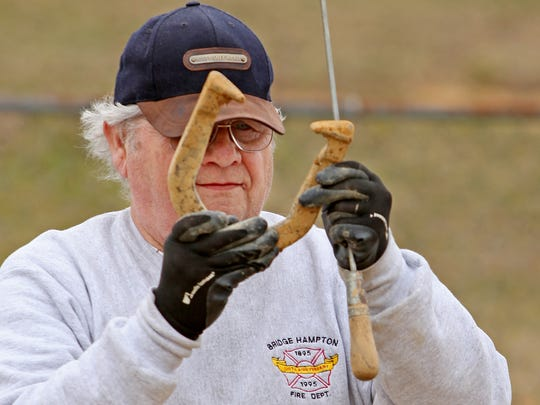 """George """"Yogi"""" Guyer of Mint Springs takes aim before his pitch at the Stuarts Draft Horseshoe Club's court at Schneider Park on Thursday, March 19, 2015."""