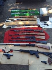 Eighteen firearms and thousands of rounds of ammunition were also seized from the Elkhorn Road property.