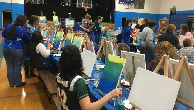 The Auburndale High School Band held a Canvas Painting Fundraiser Night on Feb. 12. The class was taught by Auburndale High School AP art teacher Kara Lasiewicz.