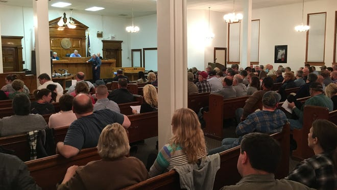 Residents fill the Grant County Fiscal Court chambers Monday night to talk about the county's possible bankruptcy and tax hikes.