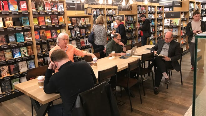 A table for reading, computer use or coffee breaks at the Amazon Books store in Dedham, Mass.
