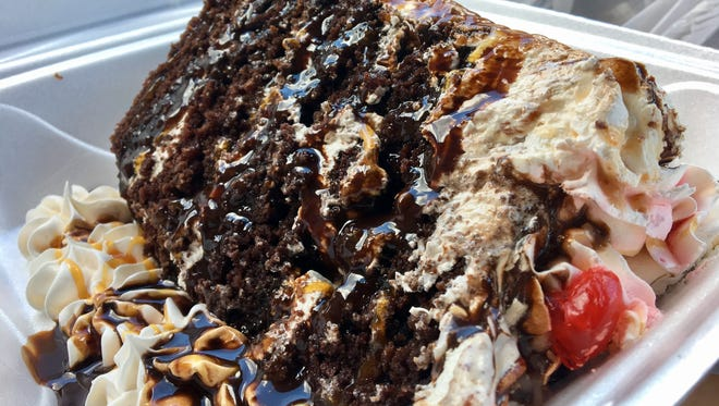 """A towering slice of the """"Better Than Sex"""" cake from Nick & Stella's in south Fort Myers."""