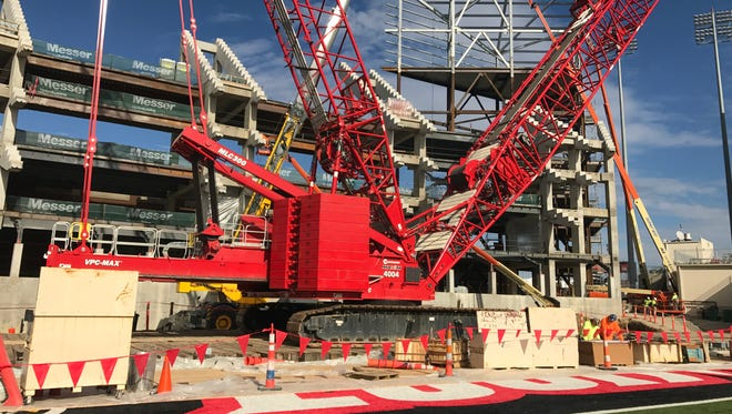 The construction cranes have moved onto the field at Papa John's Cardinal Stadium as the $63 million expansion project ramps up.