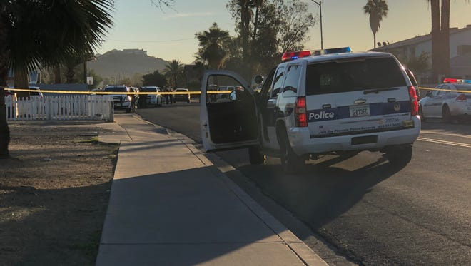 Phoenix police surround a home near 19th Avenue and Mountain View Road Jan. 31, 2018, as they respond to a domestic-violence call.