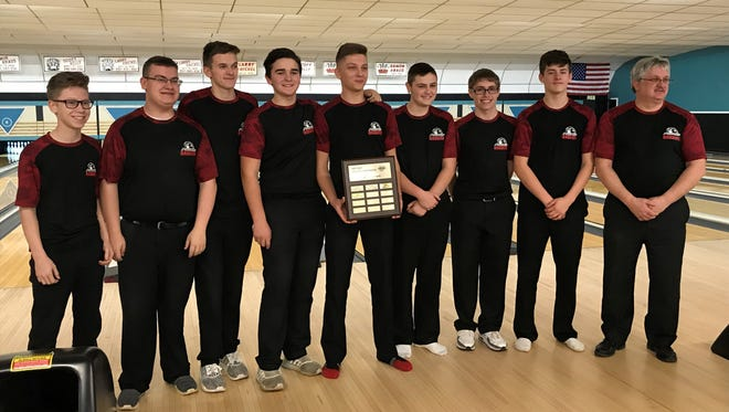 The Marion Harding boys bowling teams poses after winning the Mid Ohio Athletic Conference Bowling Tournament at Cooper's Bowl earlier this season. The Presidents will compete as a team for the first time at the Division I state tournament Friday morning at Wayne Webb's Columbus Bowl.