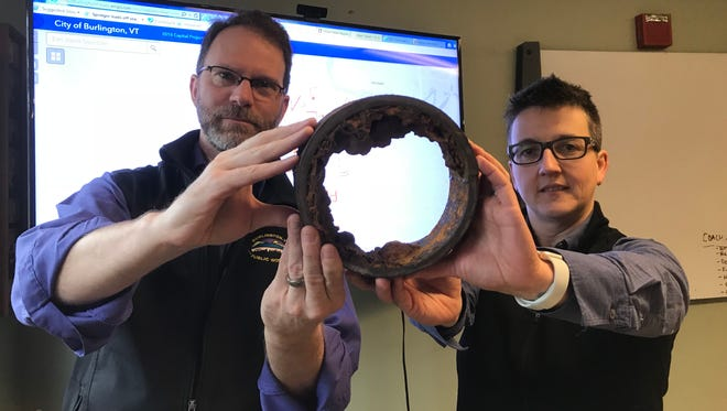 Restricted flow: Chapin Spencer, left, director of Burlington Public Works Department, and Megan Moir, the department's director of water resources, display a section of 19th-century water main on Friday, March 30, 2018. Replacement of vintage pipe in downtown will accelerate this summer, they say.