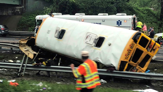 Emergency personnel respond to a crash after a school bus and dump truck collided, injuring multiple people, on Interstate 80 in Mount Olive, N.J., Thursday, May 17, 2018.