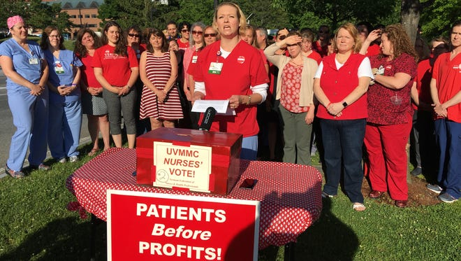University of Vermont Medical Center nurses gather Wednesday morning, June 13, 2018, for the announcement of vote results showing their union has authorized a two-day strike after the current contract expires on July 9.
