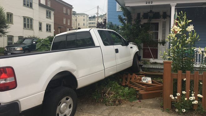 A truck was clipped Tuesday on North Lewis Street in Staunton, sending it into the porch of a home.