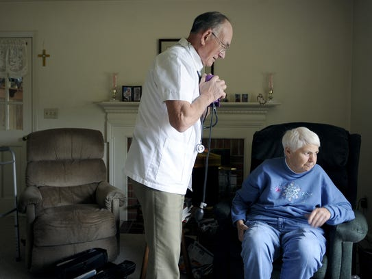 Dr. H. Lynn Moore checks Evelyn Berry's blood pressure