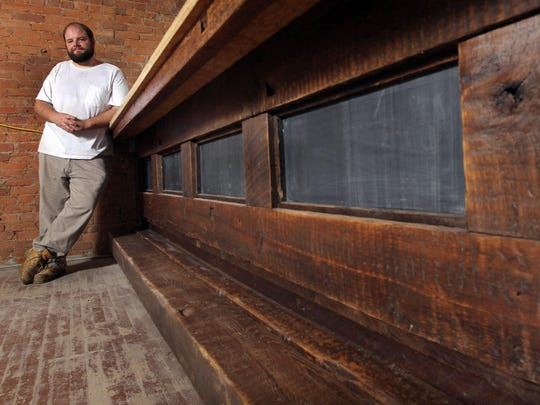 Chef Chris Burns is opening Commonwealth Bistro in the 600 block of Main Street. The bar in his bistro is constructed from beams used to construct the original building, which dates to the 19th century.