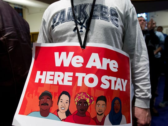 Immigrant rights advocates demonstrate against President-elect