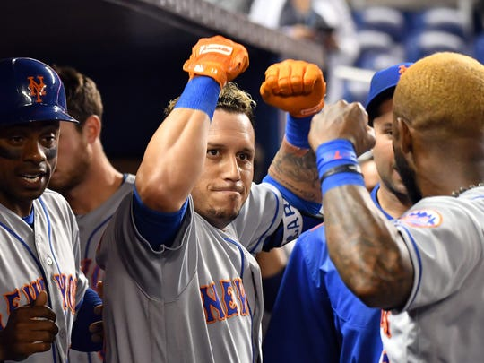 New York Mets second baseman Asdrubal Cabrera (center) celebrates with shortstop Jose Reyes (right) after hitting a two-run home run in the first inning against the Miami Marlins at Marlins Park on Wednesday, June 28, 2017.