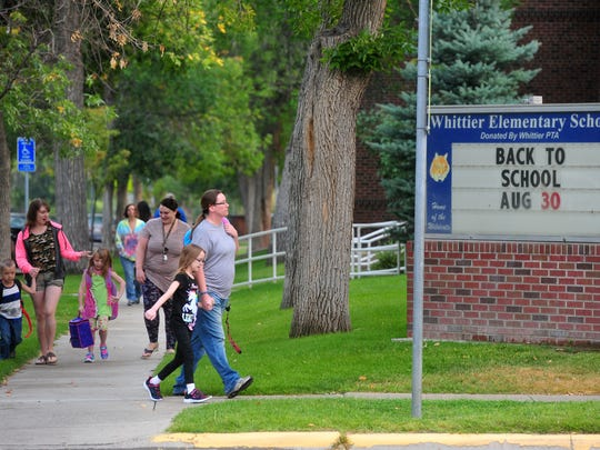 Students and their parents arrive at Whittier Elementary School for the first day of school on Wednesday morning.