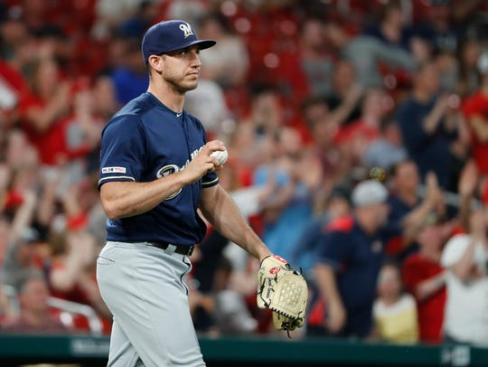 Milwaukee Brewers relief pitcher Jacob Barnes walks