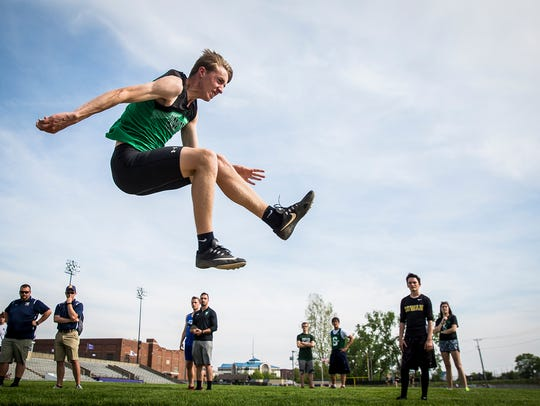 Yorktown's Max Furnish jumps in the boys track sectional