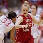 """USD's Nicole Seekamp (35) drives on Stanford's Amber Orrange during last year's NCAA tournament game in Ames, Iowa. Seekamp will try to lead the Coyotes to another Summit League title. """"We're starting over with a chip on shoulder with something to prove,"""" coach Amy Williams said."""