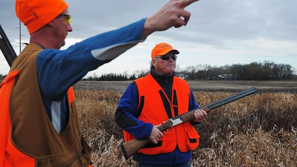 Brett Lovrien of Sioux Falls (left) and Argus Leader Media columnist Stu Whitney talk strategy while pheasant hunting near Mitchell.