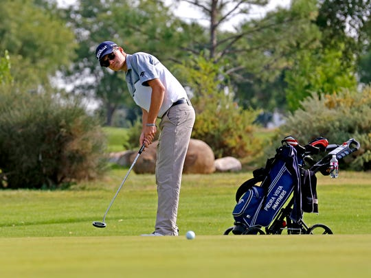 Piedra Vista junior Darius Martinez putts the ball on Monday during the Chuck Soria Invitational at Riverview Golf Course in Kirtland.