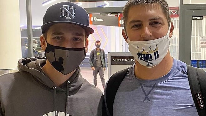 Jason Pinsonnault, left, a sophomore at Winnacunnet High School, met up with Trevor Bauer of the Cincinnati Reds on Sunday at Logan Airport in Boston.