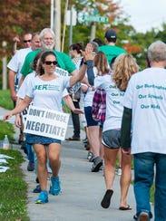 Striking Burlington teachers walk a picket line outside