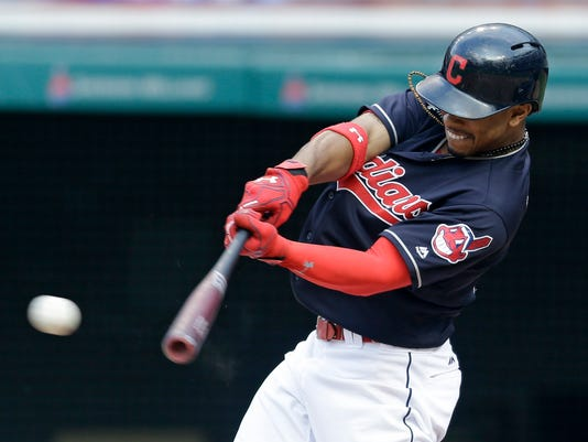 Cleveland Indians' Francisco Lindor hits an RBI-single off Kansas City Royals relief pitcher Peter Moylan in the seventh inning of a baseball game, Sunday, June 5, 2016, in Cleveland. Michael Martinez scored on the play. The Indians won 7-0. (AP Photo/Tony Dejak)