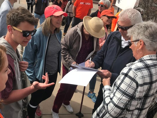 St. George residents sign a petition for volunteers