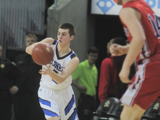 CovCath sophomore Grant Disken passes the ball during