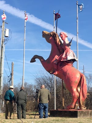 The Nathan Bedford Forrest statue on I-65 was vandalized and painted pink Wednesday, Dec. 27, 2017 in Nashville, Tenn.