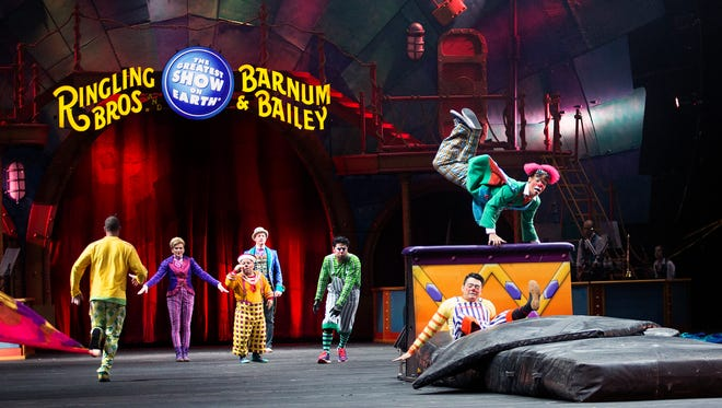 Ringling Bros. and Barnum & Bailey Circus performers parade out on to the arena floor during the opening segment of the show March 23 in Norfolk, Va.