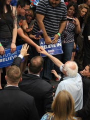 Bernie Sanders says goodbye as he exits the rally in