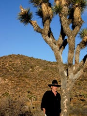 The late Ted Markland posed near his favorite spot in Joshua Tree National Park.